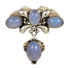 Rare and beautiful GEORG JENSEN sterling silver and chalcedony brooch.  The silver is crisply detailed and the chalcedony is luminous.Denmark circa 1915s