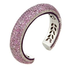 Sash Cuff - Havana Rose: The Havana Collection. Hand made from 925 sterling silver plated with black rhodium, hand-set with pink sapphires accented by glittering purple enamel.