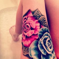 #tattoo #thightattoo Not a huge fan of flower tattoos, but I really love the colors in this one.