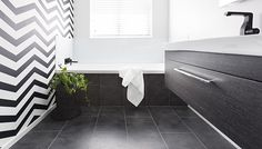 This video shows how a dated dull bathroom was renovated to bring drama and glamour to the home!