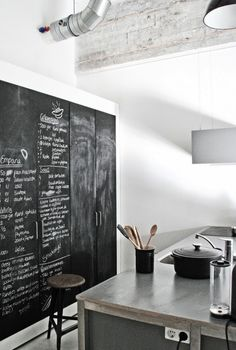 kitchen blackboard cupboards/by Renee Arns - An industrial loft in Eindhoven