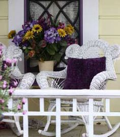 Love the big vase and the comfy looking wicker rockers.  http://www.front-porch-ideas-and-more.com