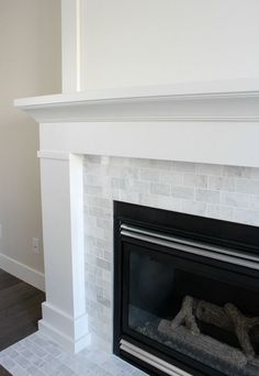 White Painted Fireplace with Marble Subway Tile - The Makeover Details - http://SatoriDesignforLiving.com