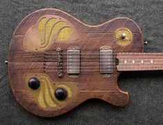 Image from http://www.destroyallguitars.com/images/galleries/DismalAx-Rusticator-3-14/DismalAx-Rusticator-02.jpg.