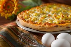 Pizza for breakfast? Just add eggs and veggies!
