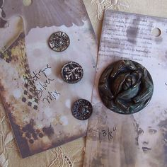 """ButtonShop.ca - 4 detailed vintage Metal picture buttons that date from the late 1800's to early 1900s.The first card features 3 antique metal buttons with back metal loop shanks.  The middle button is a picture button featuring a floral motif with faceted steel petals .. lots of 3-D detail on a smooth black background.  The other two are very detailed with pretty cut and filigree work.  All approx. 9/16"""".The second card features a gorgeous lovely cut-work rose ..."""