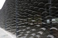 "China Academy Arts by Kengo Kuma - The outer wall is covered with a screen of tiles hung up by stainless wires, and it controls the volume of sunlight coming into the rooms inside,"" they added."