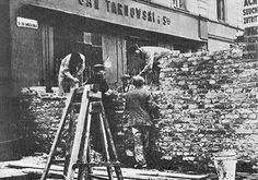 Jews building the ghetto wall, Warsaw, October 1940