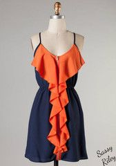 Ruffle Touch Down -- Navy/Orange Great simple, two-toned dress for the game. Spaghetti straps with draping orange ruffle and exposed zipper down the entire front of the dress.