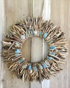 Gorgeous Driftwood Wall Wreath  with Sea Glass Handmade in USA. Featured on Completely Coastal: https://www.completely-coastal.com/2018/04/driftwood-wall-decor-art-handmade-usa-etsy.html