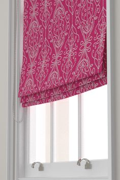 Java Flamingo / Peach  Roman Blinds by Harlequin. A raised texture with a fretwork like motif created by embroidering over a yarn with a contrasting colour.  Shown in the rich flamingo pink colourway.  Please request sample for true colour and texture.