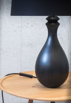 The Derome light is a statuesque table lamp available in a dark stained tulipwood. Supplied with a black coloured woven flex, a touch sensitive dimmer and euro/uk plug. UL unaccredited fittings on request. Colored Weave, Light Table, Table Lighting, Dark Stains, Furniture Design, Table Lamp, Lounge, Bulb, Vase