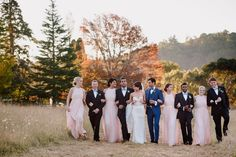 The bridal party looked incredible! Bridesmaids wore long blush halter dresses, and groomsmen donned navy suits and light blue bow ties. | Hilary Cam Photography