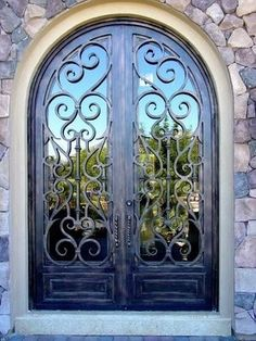Wrought Iron Doors, want these someday on me dream house!!