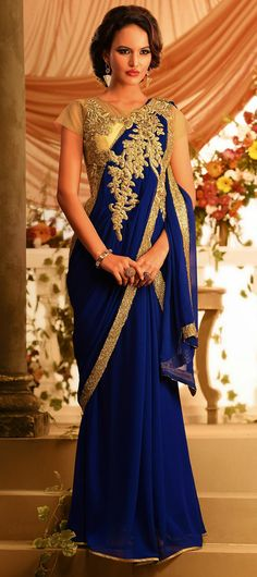 Amazingly crafted chiffon and faux georgette indowestern saree style gown. The saree style gown in blue cooler is done with the rich work of gold zardosi, resham, sequins and stone.This readymade gown has maximum bust size of 40 inches Saree Gown, Lehenga Choli, Anarkali, India Fashion, Asian Fashion, Indian Dresses, Indian Outfits, Indian Clothes, Indowestern Saree