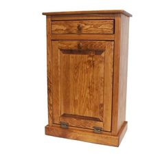 Pine Tilt Out Trash Bin Cabinet with One Drawer from DutchCrafters Amish Furniture. Made from pine wood. Bottom cabinet pulls open to reveal plastic trash bin. Can also be used as a laundry hamper. Includes a drawer under the top. Made in America in your choice of stain, paints, or primitive paint for a distressed look. #trashbincabinet #kitchen