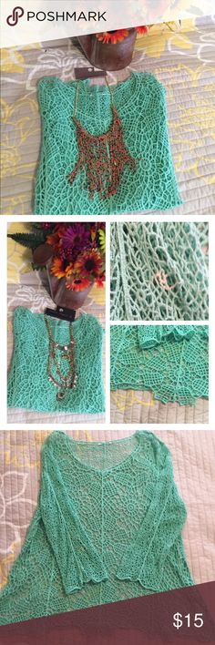 Sea foam green top I loved this top I could wear so many camisoles to change the look. It has one spot on the sleeve. When wearing you can't see it. Top to bottom is 32 bust 24 sleeves are 22 Tops Blouses