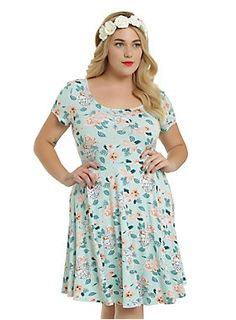 <p>Go on and kiss the girl... and bring her flowers! Fit and flare dress from Disney's The Little Mermaid with an Ariel flower print and crisscross…