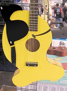 """Gold Fish Guitar  Pignose was commissioned to build some guitars for Pepperidge Farm to commemorate their popular snack cracker """"Goldfish."""" While I know that you might kill to own a guitar like this, you need to let it go, it was a one shot deal and this one is not for sale. You could always keep an eye on eBay..."""