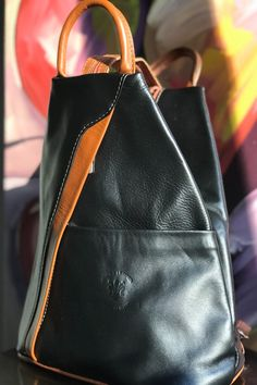 A stylish way to go when you need a hands free purse! This modern genuine Italian leather backpack bag is excellent for travel or every day use. The main compartment features a zippered enclosure to a roomy main compartment. The front slip pocket or back outside zipper pocket makes for quick access items, like your passport. #backpackbags #passportholder #fashionbackpack #fashionbagsforladies #verapelle #leatherhandbags #leatherbag #fallfashion #bagsandpurses