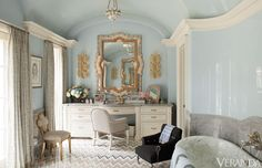 Pale blue and gold bathroom