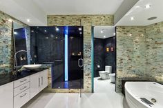 Bathroom Renovations from Granite Transformations of Northeast Ohio. Beautiful mosaic backsplash.