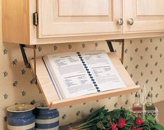 Under the Cabinet Pull Down Cookbook Holder----I think I've found something new to add to my dream kitchen <3