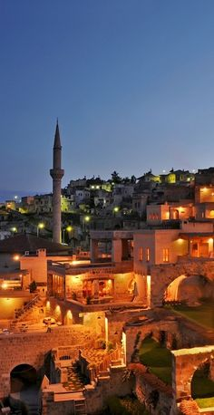 The area's ancient cave dwellings and stone churches are romantically lit at night. Cappadocia, Turkey