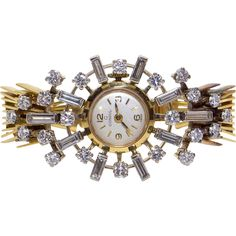 Ladies 18k Yellow  White Gold Consul Manual Wind Hilton Movement Watch weighing 55grams. Set into the bezel are 10 matching fine quality Baguette Cut