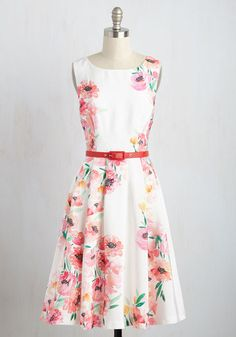 Hotline Spring Dress  Hear that ringing? It can only mean one thing - that this white midi dress is calling on you to create a chic ensemble! Part of our ModCloth namesake label, this A-line is here to tell you that its watercolor-inspired print of hot pink poppies and verdant leaves, its red belt, and its voluminous, pocketed skirt will bring springtime cheer to any time of year. The post  Hotline Spring Dress  appeared first on  Vintage & Curvy .  http://www.vintageandcurvy.com/p..
