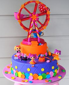 Lalaloopsy cake. Note figurines  fairest wheel are plastic toys