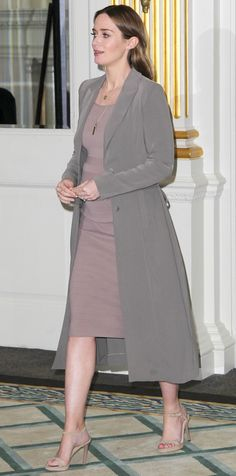Expectant mom Emily Blunt was completely radiant at The Huntsman Winter's War photocall in top-to-toe chic neutrals—she layered a slate gray coat over a taupe knit dress that hugged her growing bump. She finished with layers of necklaces and nude strappy sandals.