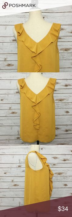 Rachel Roy Goldenrod Yellow Ruffle Sleeveless Top RACHEL Rachel Roy. Size 6. Goldenrod Yellow. Sleeveless. Center Ruffle. Delicate textured Hem. V Neck. Faux Silk. See photographs for measurements. Excellent Preowned Condition. RACHEL Rachel Roy Tops Blouses