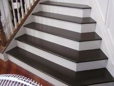 : like the dark brown of these painted stairs ... lighter to white risers are a great contrast.