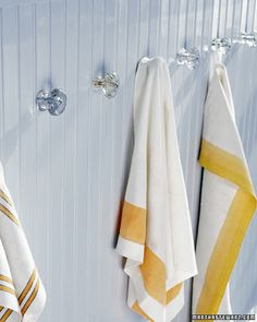 Glass door knobs as towel hangers.  Love it.  Good-bye towel bar in the bathroom!