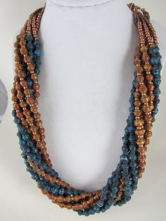Hey, I found this really awesome Etsy listing at https://www.etsy.com/listing/113707776/8-strand-necklace-hand-crafted-paper