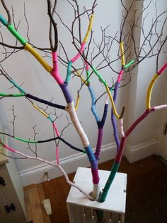 Yarn Bombed Branch... could use this to celebrate things we've learned by hanging the learned concept on the tree.