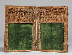 Writing Tablet Date: 14th century Culture: British Medium: Boxwood Dimensions: H. 11.5 cm (a & b) , W. 16.3 cm (4 1/2 x 6 3/8 in.) Classification: Sculpture-Miniature-Wood Credit Line: The Cloisters Collection, 1966