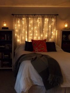 I like this idea, with the lights behind real curtains instead of just white gauze ones. Pretty but also grown up