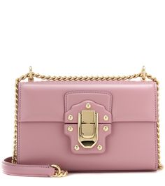 Dolce & Gabbana - Lucia Small leather shoulder bag - Crafted from mauve-hued leather, the Lucia Small bag from Dolce & Gabbana is a stunning choice for sophisticated style. The bright golden chain strap can be worn long over the shoulder or doubled up for a shorter drop, while the lock-and-buckle front fastening adds signature appeal. Style yours with elegance dresses and downtime knits alike. seen @ www.mytheresa.com