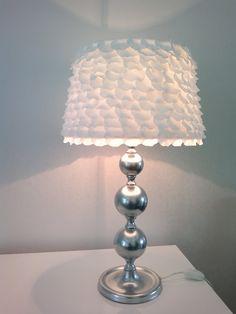 IKEA Hackers: Petal light.  Glue fake flower petals from wedding decor onto lamp shade with hot glue.  Too cute.