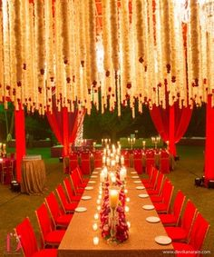Wedding Decor - Red Themed Decor | WedMeGood Red Drapes and Red Seating Decor, Dim Light Candles and Hanging Floral Ceiling #wedmegood #wedding #decor #candles #red