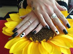 Acrylic nails with black polish ,freehand nail art on ring fingers