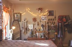 Laura of Roots and Feathers Boho Bedroom. love how all the jewelry / hats / bags look like art hung up on the walls. Seems a little busy for my taste, but I like the vibe and how you see everything.