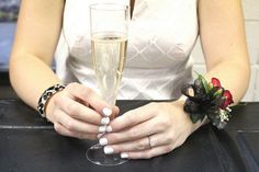 From Mrs. Sword's black and white bridal shower.  Corsage and champagne plus bridal white nails.