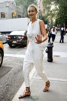 White Jumpsuit Model Off Duty Street Style Gigi Hadid Top Knot Flat Black Lace Up Sandals Fashion Mode, Womens Fashion, Fashion Trends, Net Fashion, Street Fashion, Latest Fashion, Fashion Ideas, Style Gigi Hadid, Mode Plus