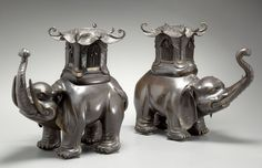 A PAIR OF TWO JAPANESE BRONZE ELEPHANT LAMPS