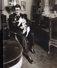 Yves St. Laurent and one of his long line of French Bull Dogs.