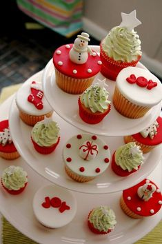 A tray of wonderful looking Christmas inspired cupcakes. The cupcakes are designed differently from one another each embodying a symbol for Christmas and they simply look perfect when grouped together.