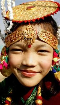 Nepal, Limbu community. My MIL (though not Limbu) used to have a gold disc headdress like that. Tragically stolen by bandits. FWIW this doesn't look like real gold to me
